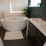 Jet Black Slate tile and Jet Black Slate Ledgestone installed in a bathroom