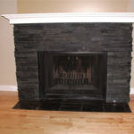 Jet Black Slate Ledgestone and Tile installed on a fireplace