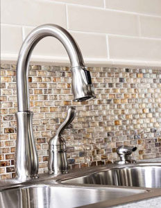 Vintage Studio Glass Varnish mosaic installed as a backsplash