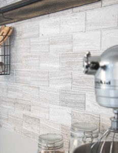 Stream Stone Natural Stone Field Tiles in Transitional Taupe installed as a backsplash