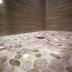 Kootenay Flat Pebbles installed in a shower