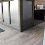 Alberta Back and Neck clinic reception with Century Wood Dune installed