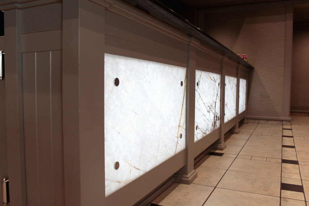 Xilo Onyx Panel Installed At A Hotel Reception Tile