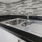Fusion Clay Random Strip Glass Tile Mosaic installed on a backsplash