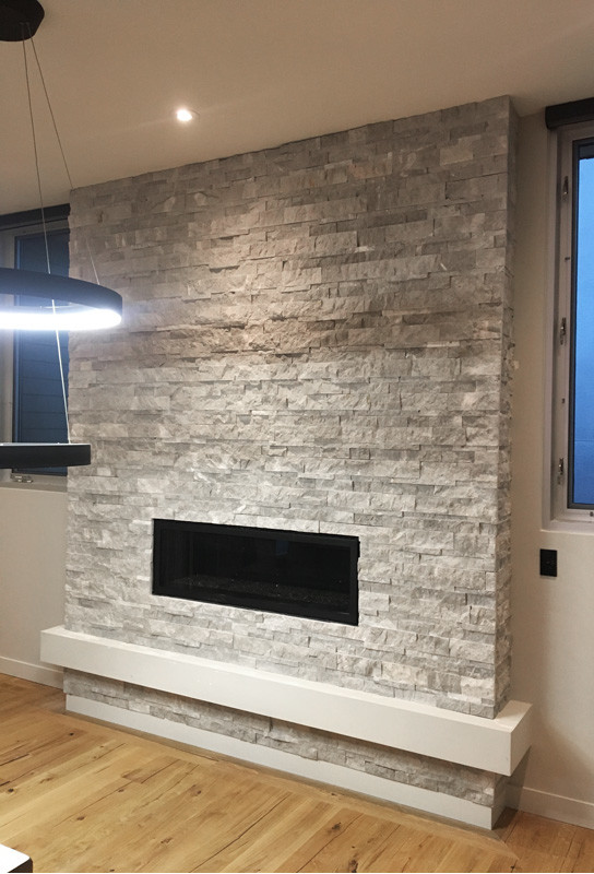 Ritz Gray Marble Splitface Installed On A Fireplace Tile