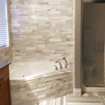 Bianco Cobalt Cubic Ledgestone and Equator Marble Tile installed