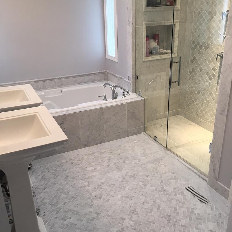 Bianco Cobalt Marble Tile And Carrara Mosaics Installed In A Bathroom