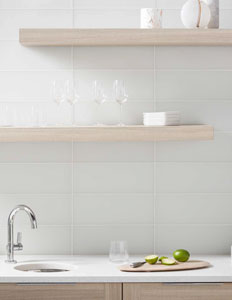Jeffrey Court Chapter 6, Reef Glass 6x16 Lily Field Tile installed as a kitchen backsplash